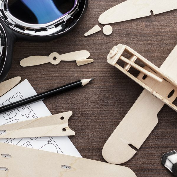 handmade-airplane-on-brown-wooden-table-P5WND7W